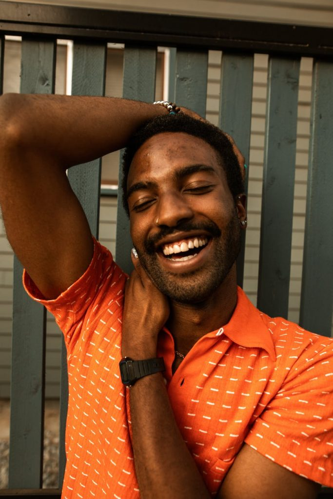 man in red polo shirt smiling